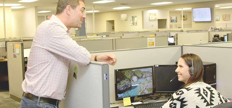 man talking to woman at call center